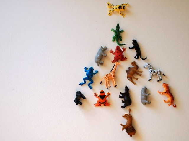 plastic animals arranged like a christmas tree