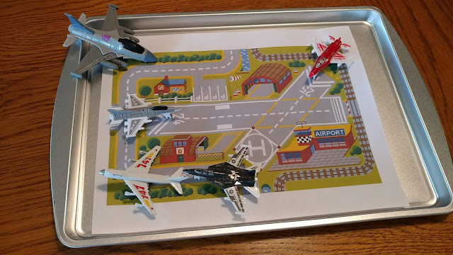 Printed airport scene with toy airplanes