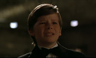 A young Bruce after witnessing his parents' death in Batman Begins (2005)