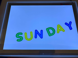 light panel with colorful acrylic letters spelling SUNDAY