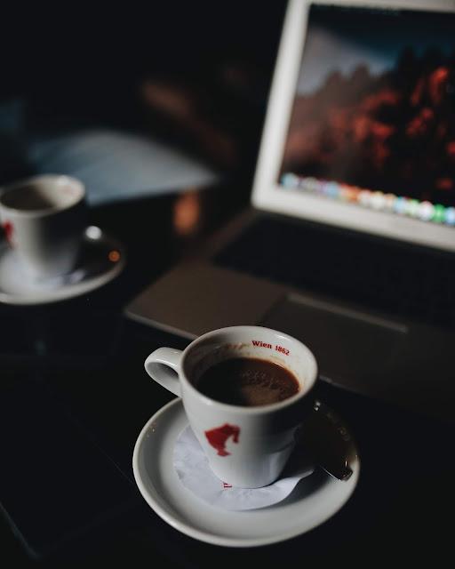 laptop and coffee Photo by Barna Kovács on Unsplash