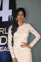 Chandini Chowdary in white Tight dress at Shamanthakamani pre release function ~  Exclusive 031.JPG