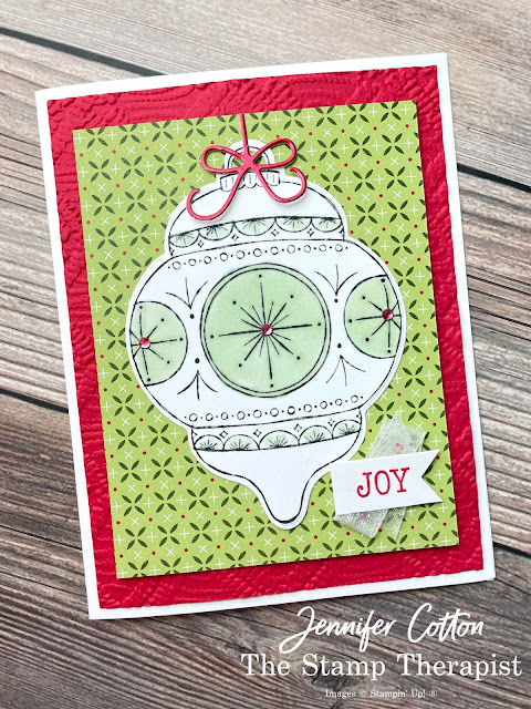 Stampin' Up! Bright Baubles Bundle card.  I also used these papers: Heartwarming Hugs DSP and Red & Green Foil.  Also: Macramae embossing folder, Red Rhinestones, Stampin' Blends, and White Glittered Organdy Ribbon.  #StampinUp #StampTherapist #BrightBaubles