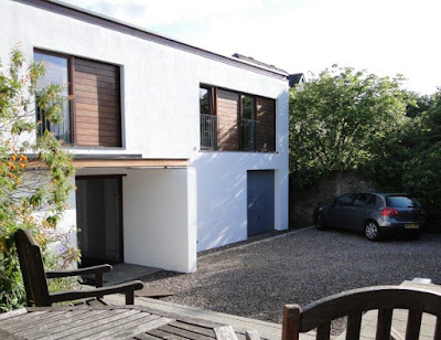 The N80 902 style garage door reinstalled on the modernised property