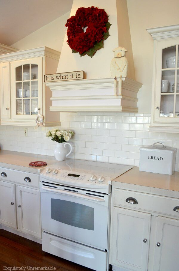 Red hydrangea wreath On cream colored Kitchen Hood