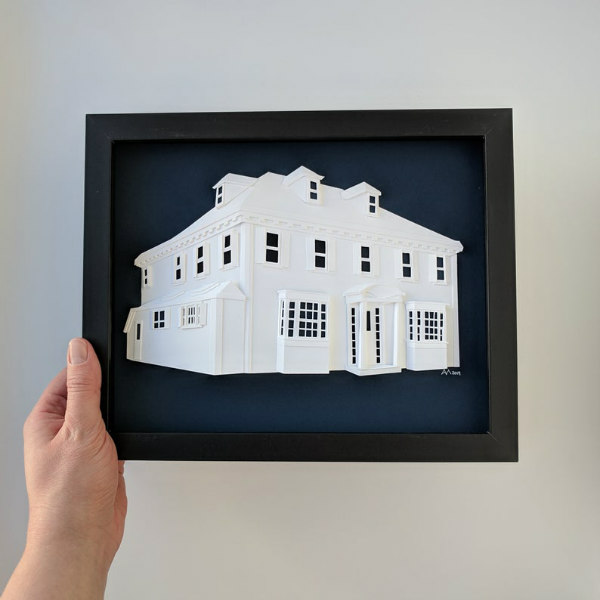 framed dimensional white paper sculpture of a home