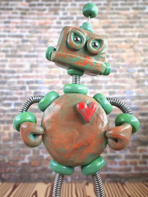 09-Patina-Phil-Garden-HerArtSheLoves-Clay-Robot-World-Sculptures-www-designstack-co