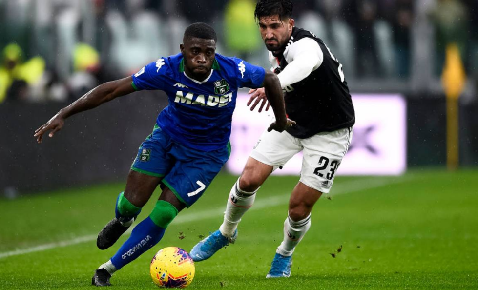 Sassuolo midfielder Jeremie Boga challenges Emre Can for the ball