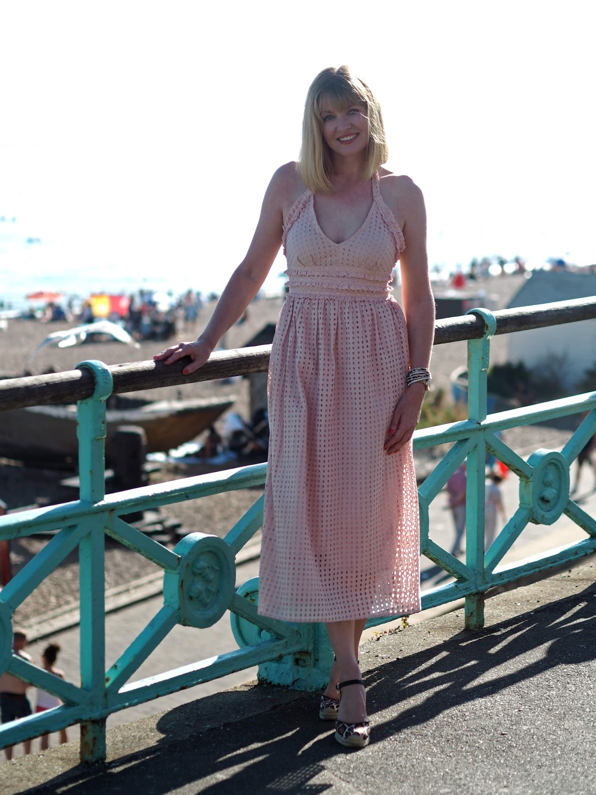 pink broderie anglaise ruffle halter neck midi dress with leopard print espadrilles, Brighton