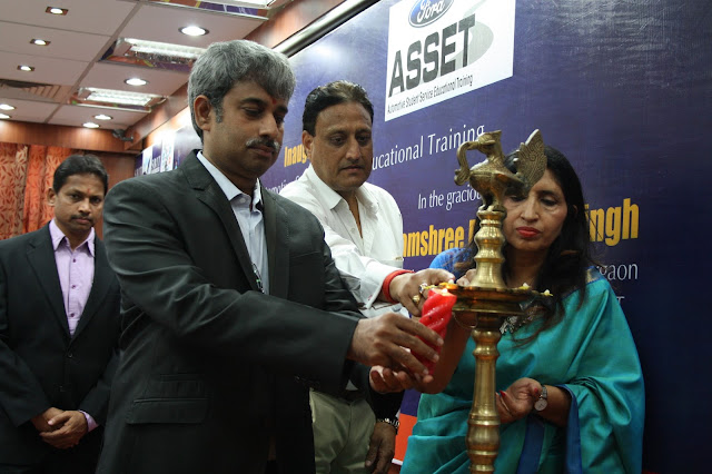 N Prabhu lighting the lamp during the inauguration of the ASSET Centre