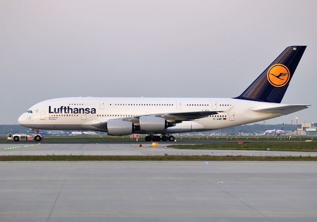 Lufthansa Airbus A380-800 is being towed