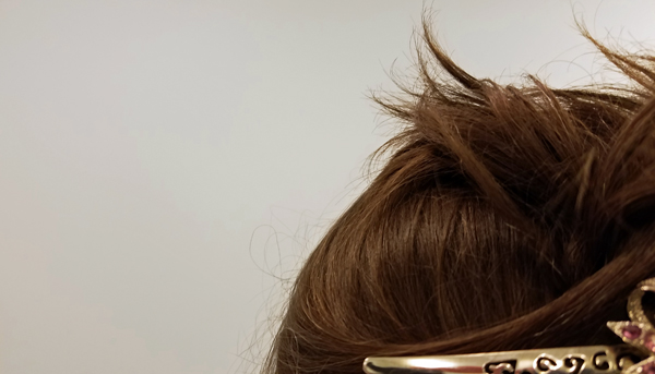 image of part of the back of my head, off-center, with only a bit of the silver hair clip showing