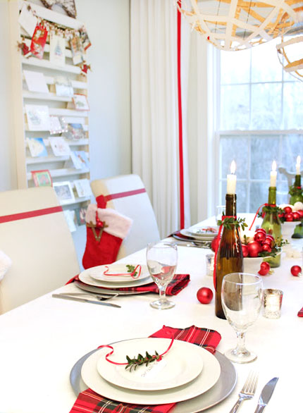 red and white dining room with green bottle centerpiece