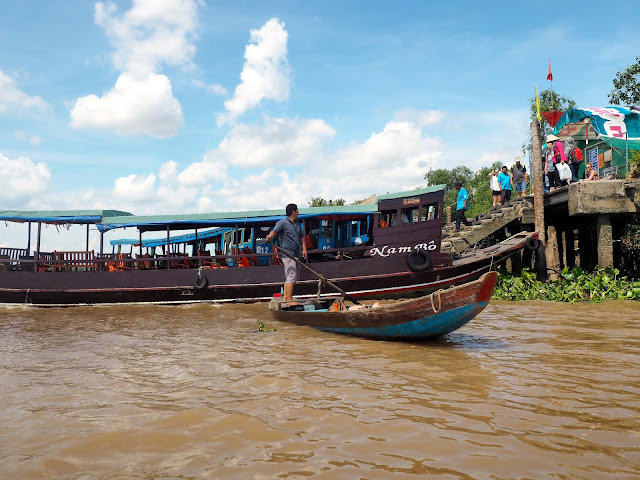 Large and small traditional wooden boats in the Mekong Delta, Vietnam
