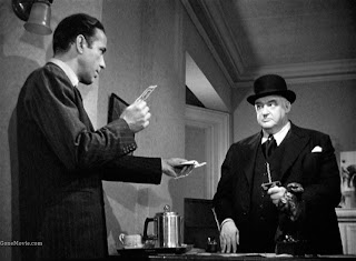 Humphrey Bogart as Sam Spade, Sydney Greenstreet as Kasper Gutman in The Maltese Falcon