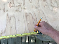 """Marking out 16"""" on our piece of plywood"""