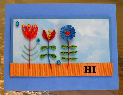 blue quilled card with colorful flowers