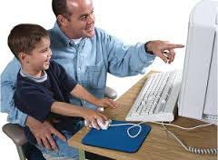 Father and Kid sitting in front of a computer