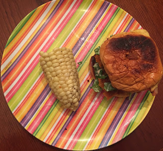 salmon lemon burger and corn