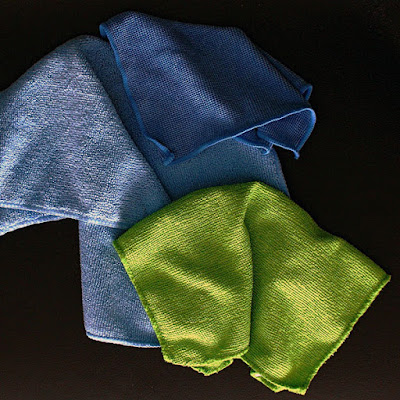 Microfiber towels in light blue, blue, and green