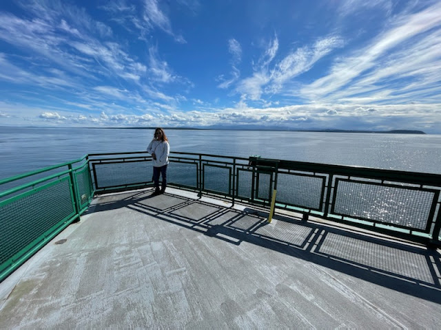 Enjoying the ferry ride and the beautiful weather. The clouds were amazing