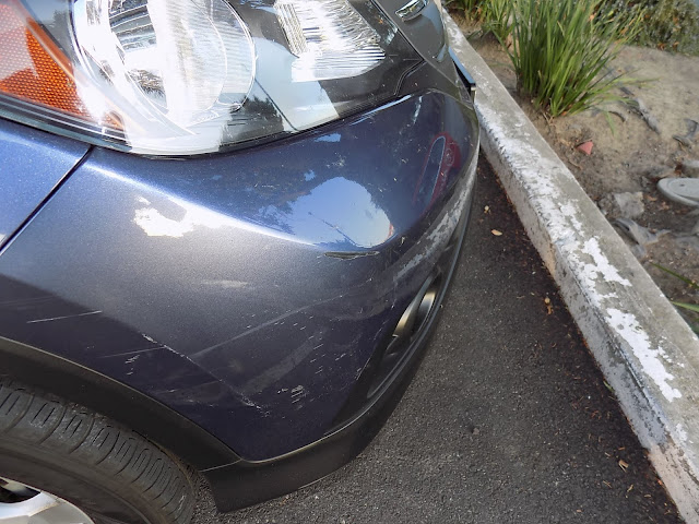 Scraped bumper at Almost Everything Auto Body for repairs & repaint.