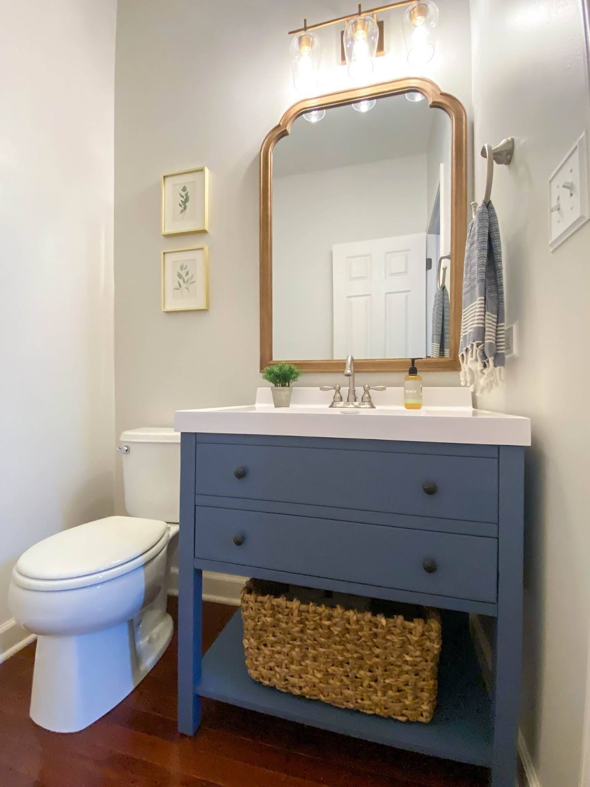 blue painted vanity in powder room
