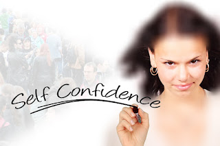 "Woman with brown hair confidently writing ""Self Confidence"""