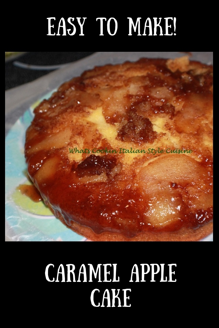 This is a semi homemade caramel apple cake. The cake has caramel on the bottom made baked in the pan with fresh apple slices and the cake is baked on top of the apple caramel syrup. It is on a plate that the caramel while hot is dripping onto the cake.