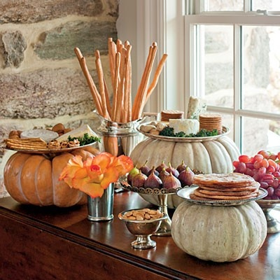This appetizer table is festive for fall with snacks served on pumpkins.