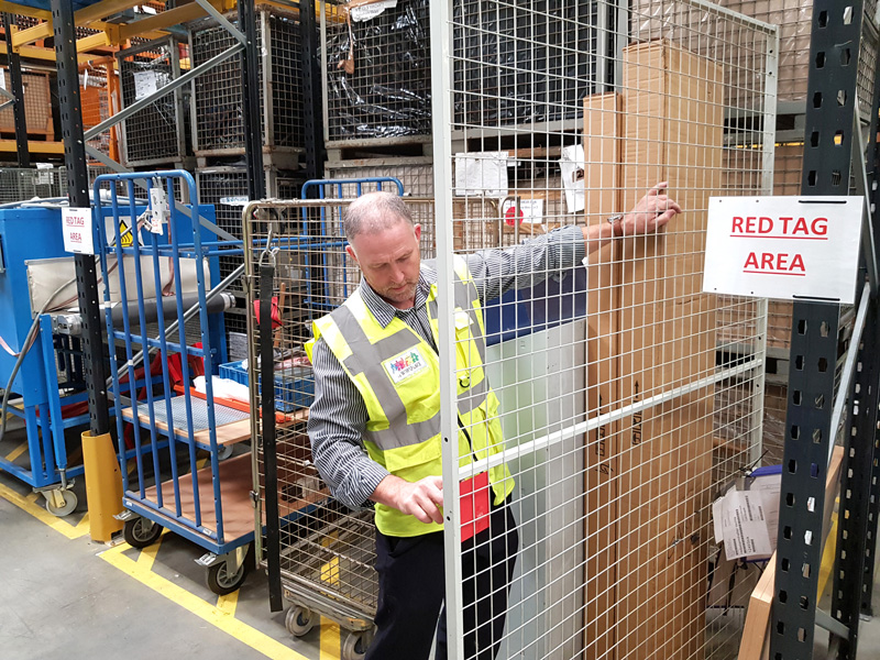 David Burton examines items in the red tag area at Garador's Yeovil production facility