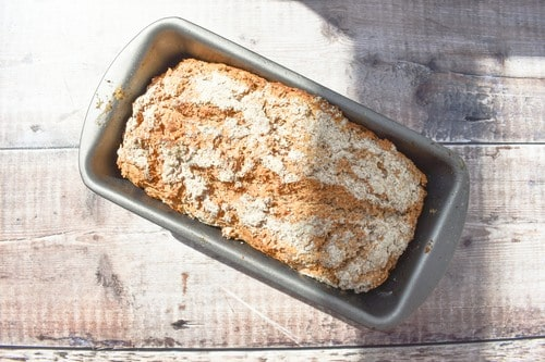 Wholemeal Beer Bread - STEP EIGHT - BAKE - an overhead shot of the golden baked loaf in the loaf tin