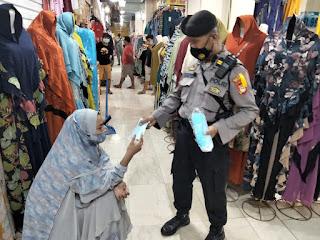 Tingkatkan Operasi Yustisi, Polres Pelabuhan Makassar Gencarkan Patroli dan Bagi Masker