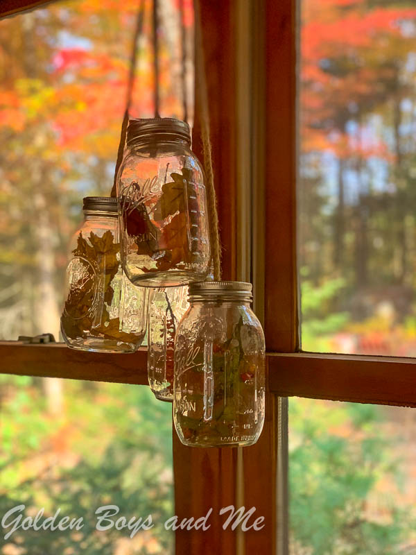 DIY mason jar chandelier with fall leaves - www.goldenboysandme.com