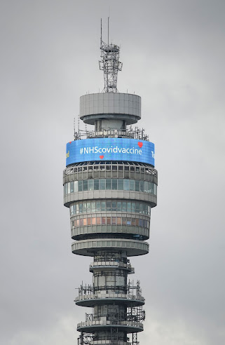BT Tower is circular, a tube, this is the banner on the other side saying #NHSCOVIDvaccine