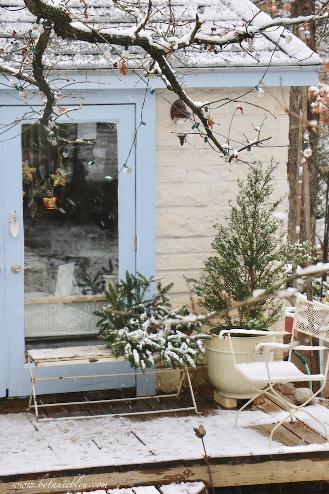 Snow on the deck of the French country garden shed created a magical snowy winter scene