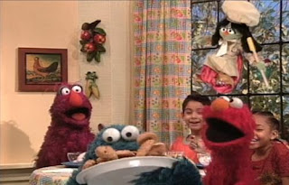 Elmo, Telly finally complete making ice cream. Cookie Monster eats Cookies.