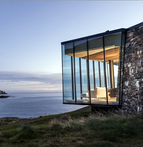 rumah minimalis dinding kaca miring