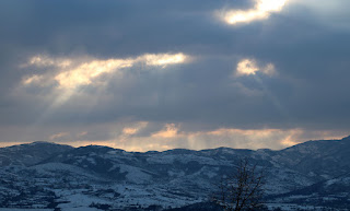 The sun shines through gaps in the clouds