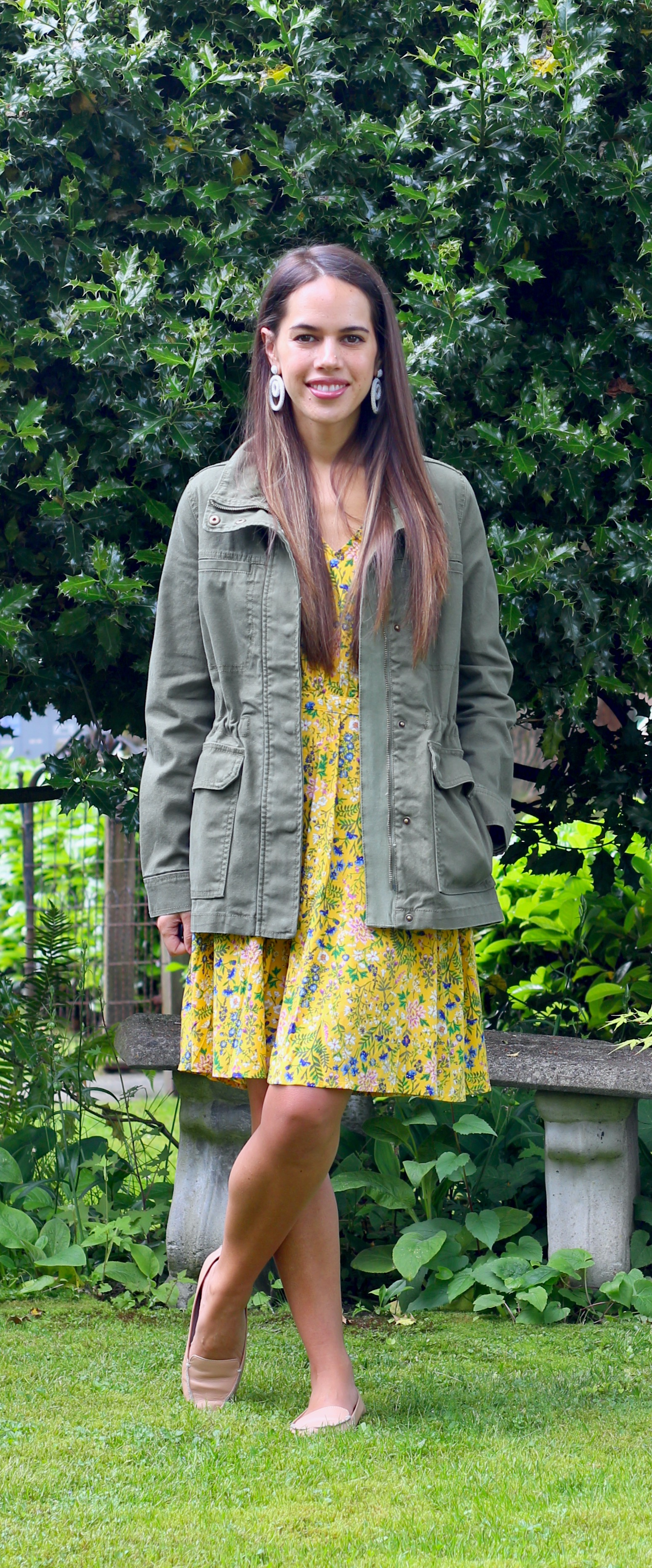 Jules in Flats - Waist-Defined V-Neck Floral Dress with Madewell Dispatch Army Jacket and Statement Earrings