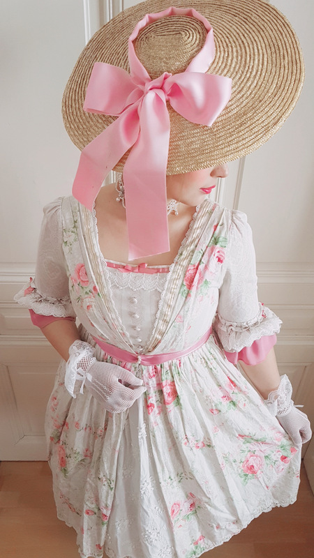 woman wearing a bergere with pink ribbon