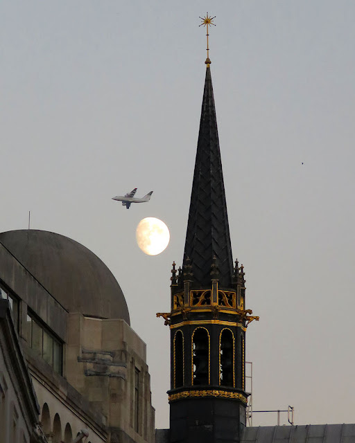 The Atkinson Carillon, with the moon and a plane Old Bond Street, London