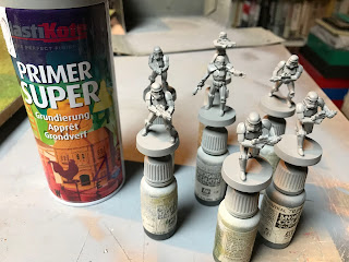 Spray grey primer on the figures to give them a base coat