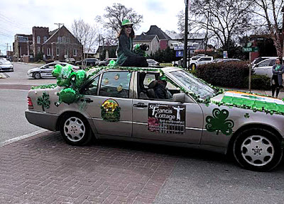 St. Patrick's Day Parade, Chattanooga, TN, Nancy and Mini Bobo ride atop our car.