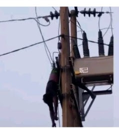 Graphic! Man Found Dangling Dead On An Electric Pole In Abuja