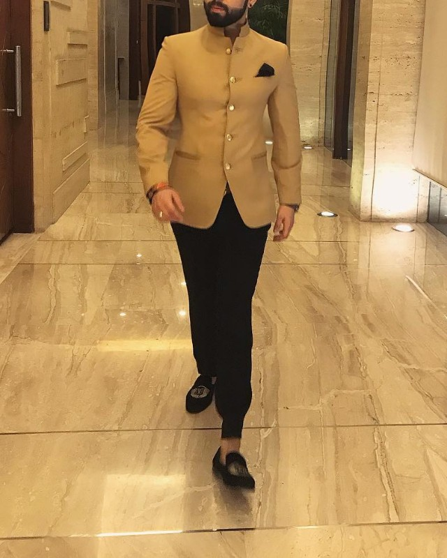 A man in trousers, slip-ons and Nehru jacket