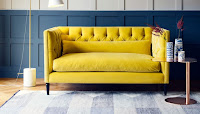 Living room furniture idea with yellow velvet sofa