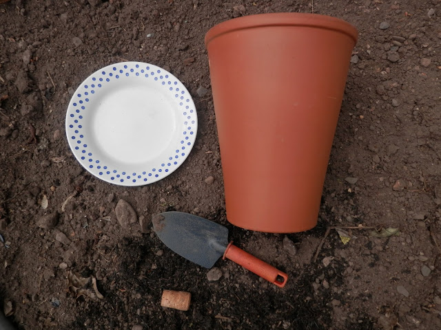 3 ways to water your garden without the hose pipe, ollas, wine bottle waterers and mulches.  Info and DIY instructions to make your own ollas, clay pot irrigation, wine bottle waterers, and mulch with twigs, pebbles and chop and drop techniques.  From UK suburban permaculture gardening blogger secondhandsusie.blogspot.com #ollas #claypotirrigation #winebottlewaterer #mulch #chopanddrop #permaculture #suburbanpermaculture