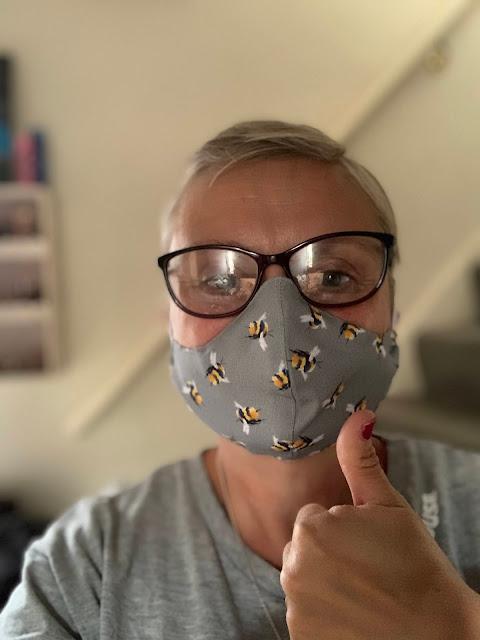 madmumof7 wearing COVID-19 mask