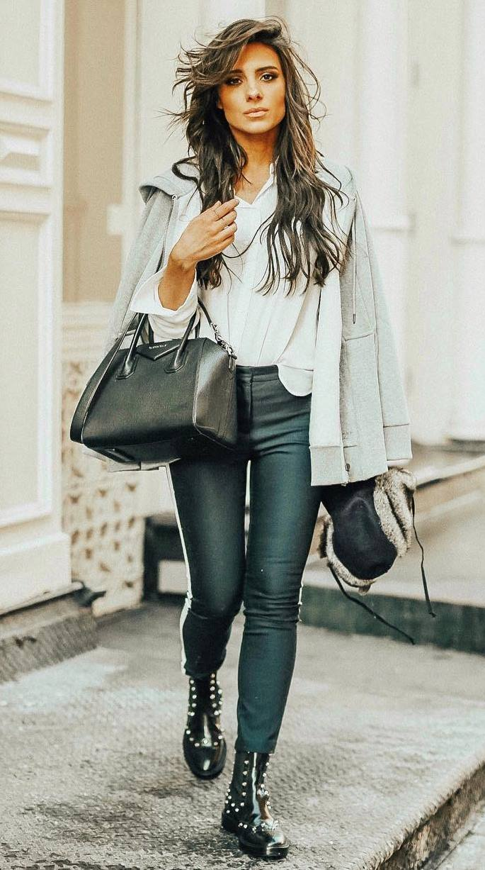 fashion trends | bag + black skinny pants + boots + white top + grey cardigan